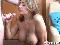 Mature swinger Sandie Marquez is swallowing a stiff cock