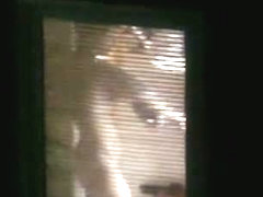 Nude candid female with a big sexy ass filmed through a window