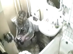 Blonde was caught in the intimate moment of peeing on toilet