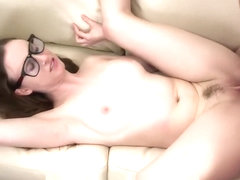 Naturally horny girl gets a super creamy load of cum on her big glasses