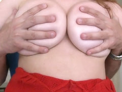Heavy chested Kelsey Michaels teases in close up