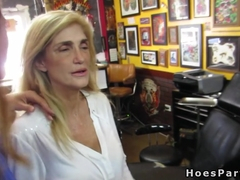 Hot babes in orgy party in tattoo shop