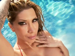 Kayla Carrera plays with twat near swimming pool