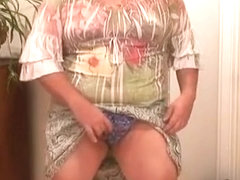 Chubby crossdresser in skirt and panties