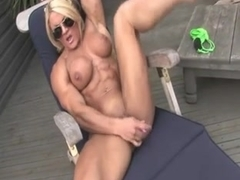 Muscle Goddess dildoing her pussy in the garden