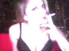 BEAUTIFUL BLONDE WOMAN WITH RED LIPSTICK SMOKING OUTSIDE AT NIGHT (SOLO)
