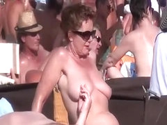 Blowjob in crowded nudist beach