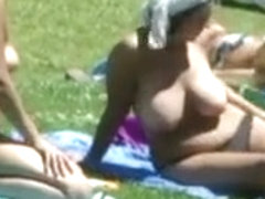 Busty Chick Tanning Outdoors Topless