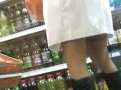 Upskirt stockings in a market