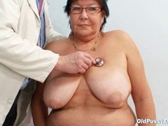 Breasty elder woman gyn clinic exam