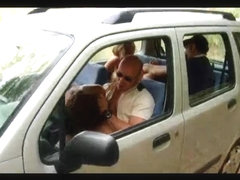 2 couples in car on the road